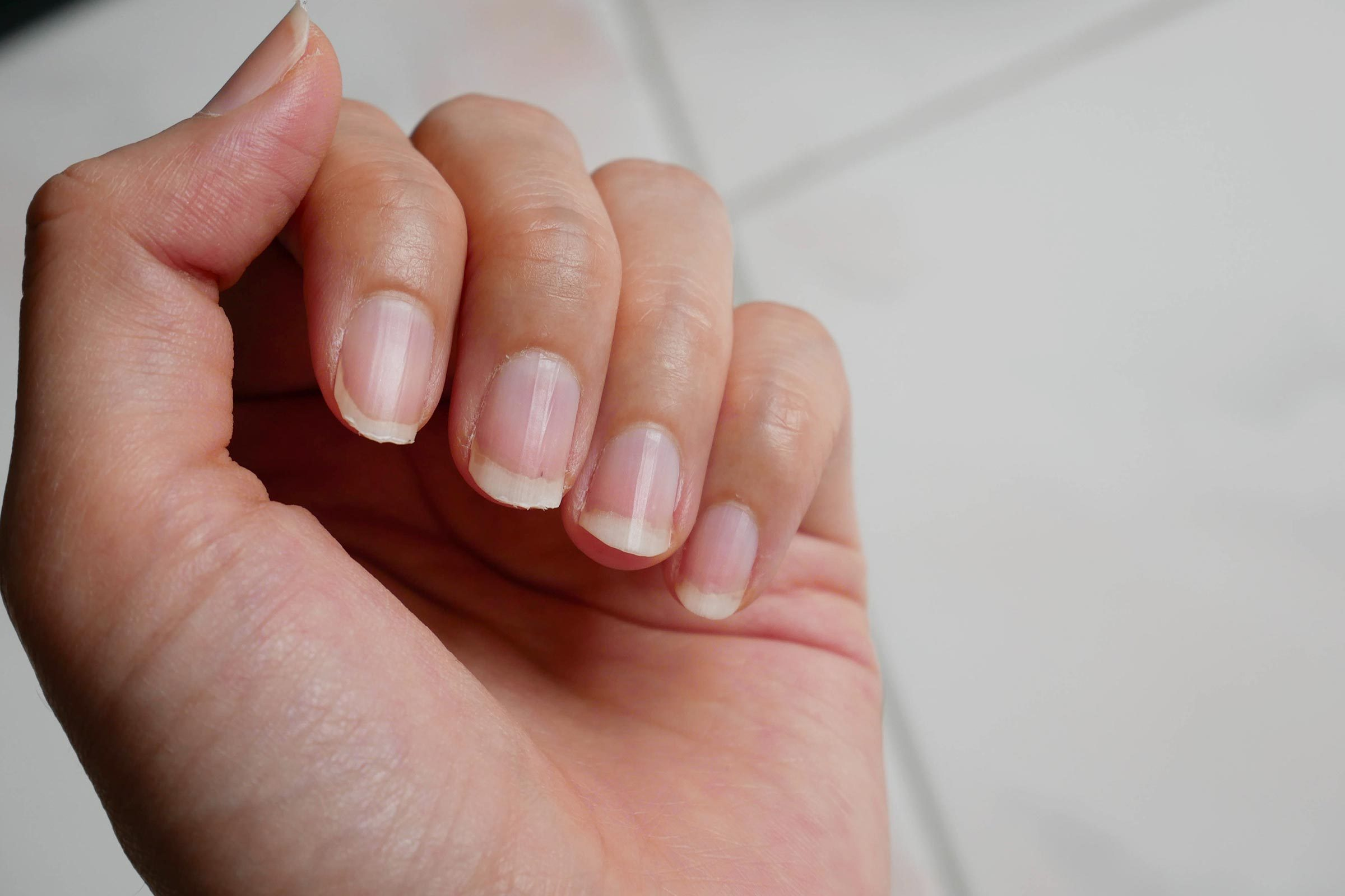 a woman's hand, with the palm and nails visible