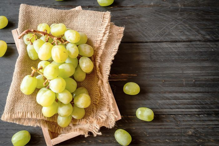 fresh green grapes on wood background