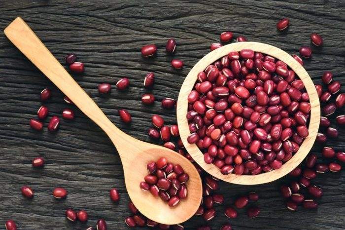 Red beans in wooden on wood background