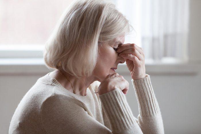 woman headache senior