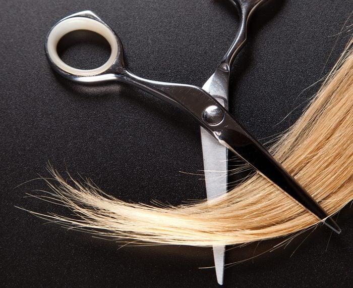 professional hairdresser scissors on dark background