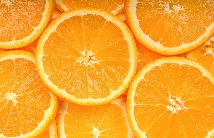Close up slice orange fruit background texture.