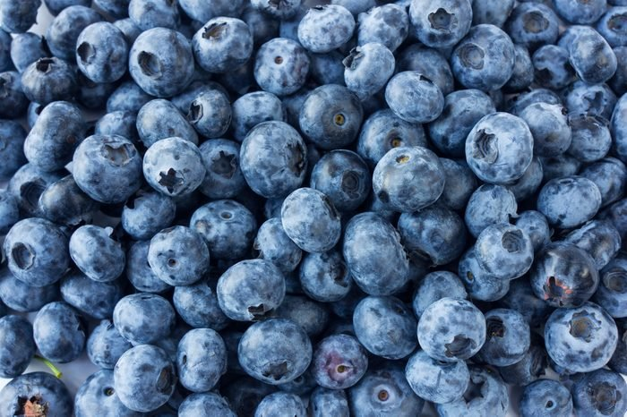 Fresh Blueberry Background. Texture blueberry berries close up. Various fresh summer berries. Top view.