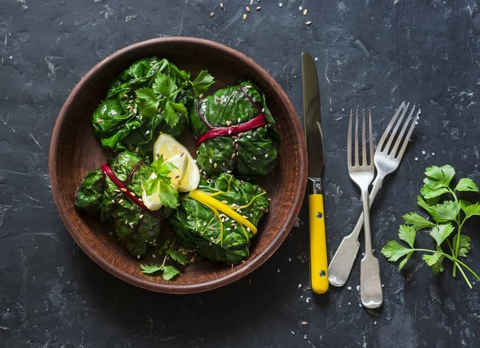 Vegetarian swiss chard packets. Chard leaves stuffed with turmeric lentils and vegetables. Vegetarian healthy food concept
