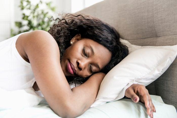 Beautiful black woman on a white bed sleep