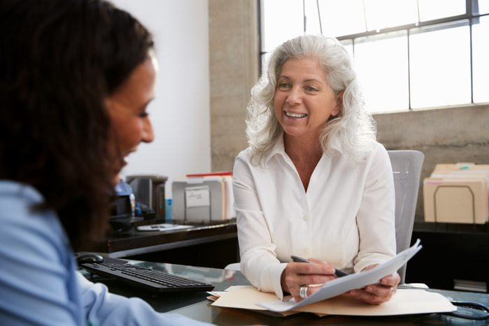 Senior professional woman meeting in office with young woman