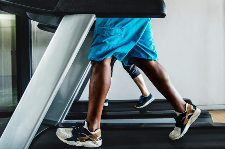 Man running on a treadmill at the gym.