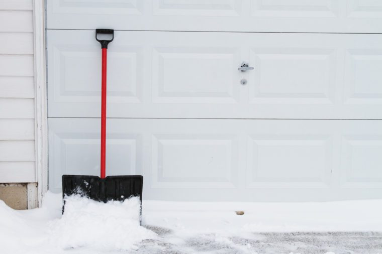 snow shovel on garage door