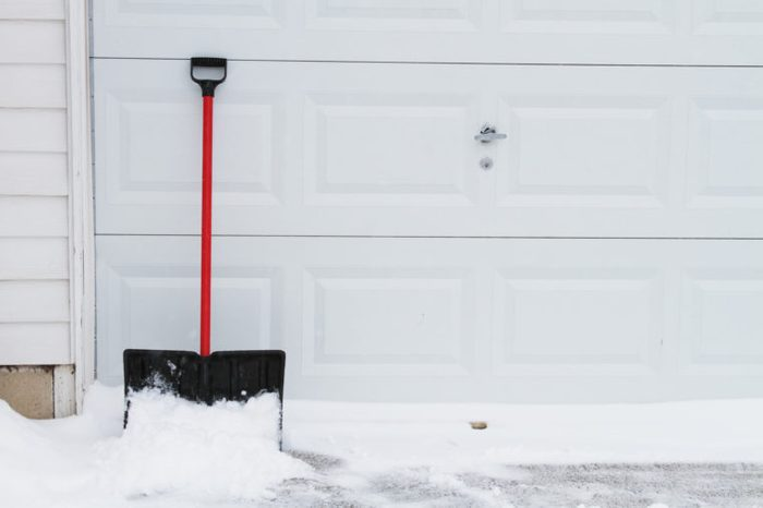 snow shovel on garage door