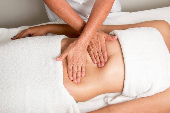 Massage Therapist Massaging a Women's Stomach