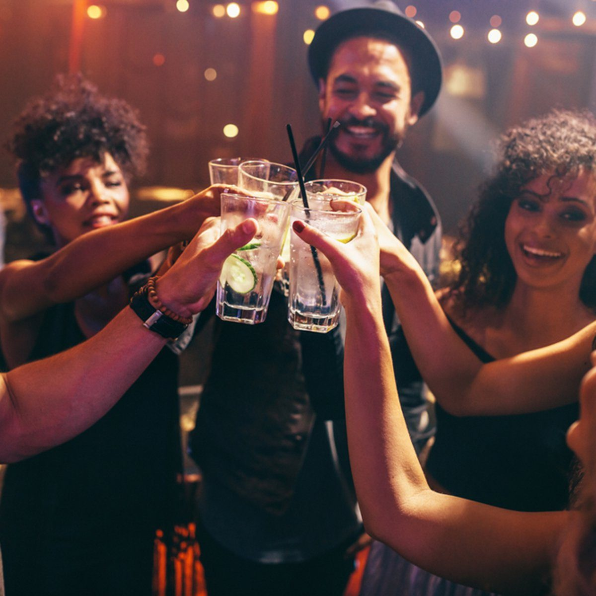 Group of friends having drinks at the night club party.