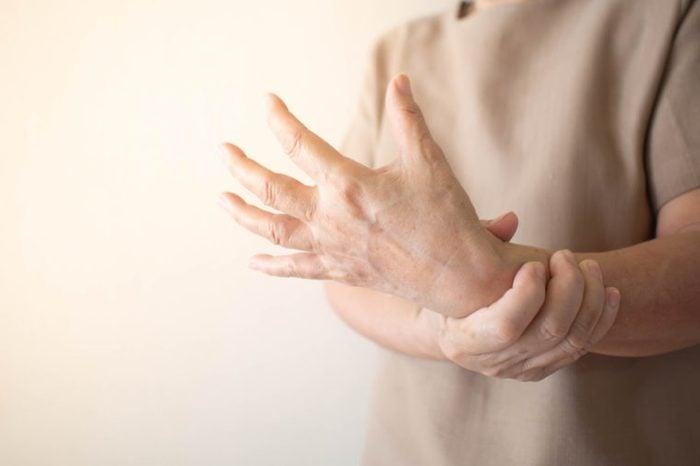 man with wrist hand bone pain