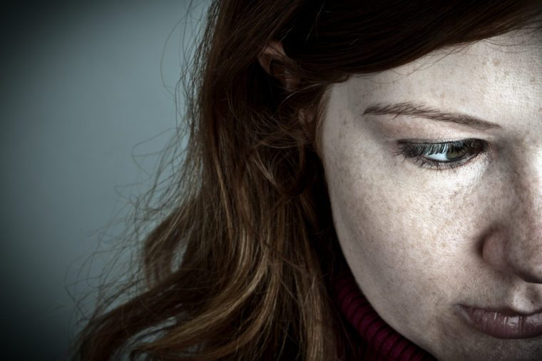 pale red headed woman with freckles