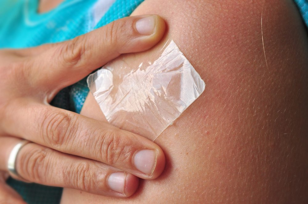 Nicotine patch on skin, quitting smoking