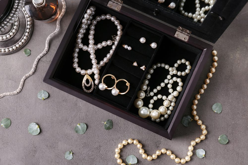 Jewelry and box on gray background