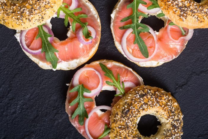 bagels with salmon , cream cheese and onion