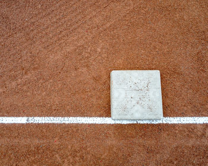 Little league bases on high school baseball diamond.