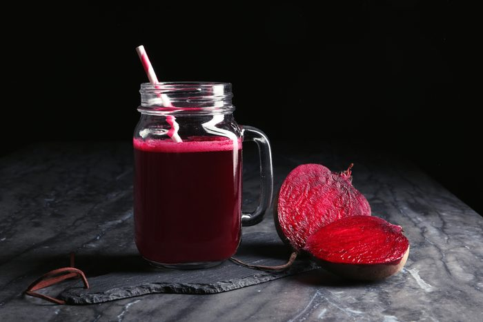 Mason jar of beet smoothie on table
