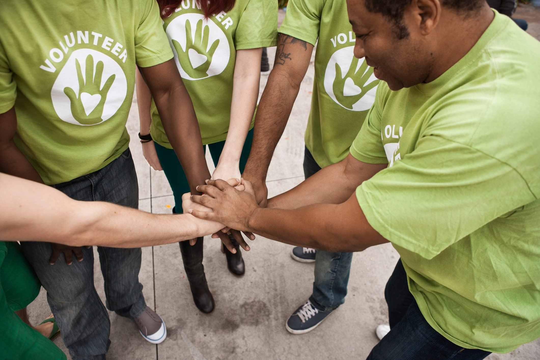 volunteers holding hands