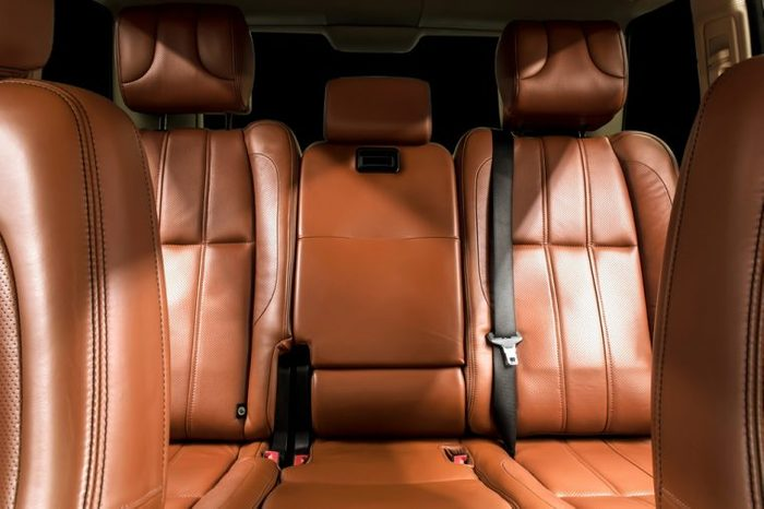 Business car interior. with brown rear leather seats.