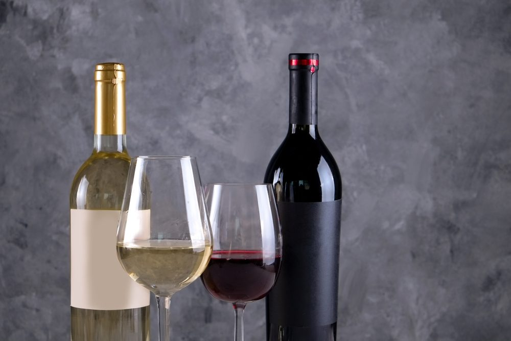 Bottle and glass each of white and red wine