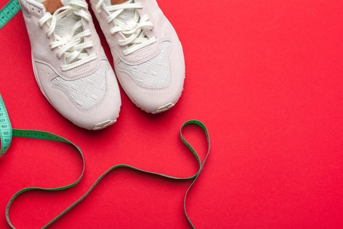 Pair of sport shoes on colorful background. New sneakers