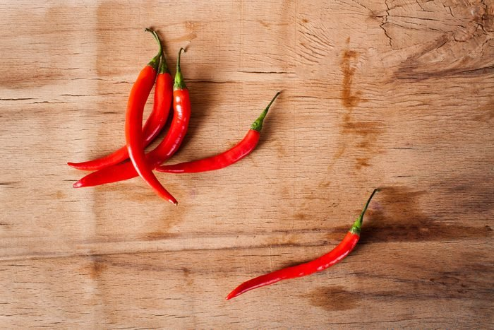 Chili peppers on a wooden cutting board