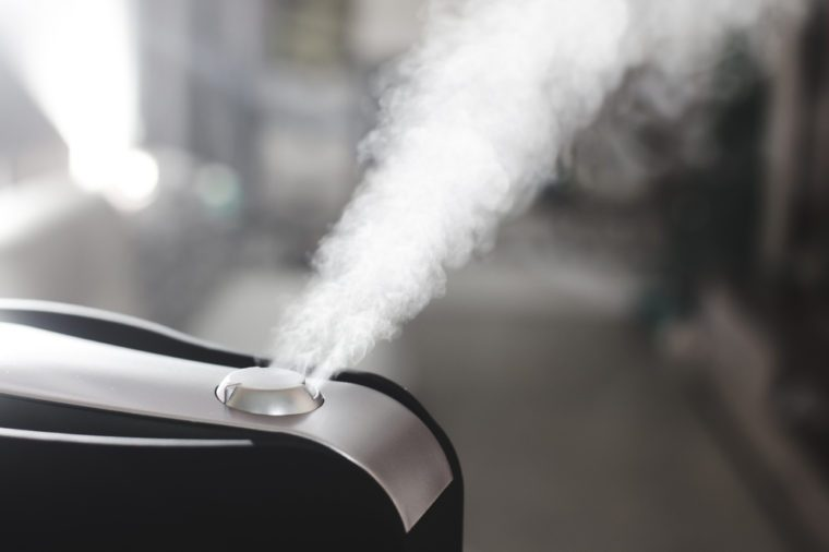 The steam from the humidifier at night in the dark black