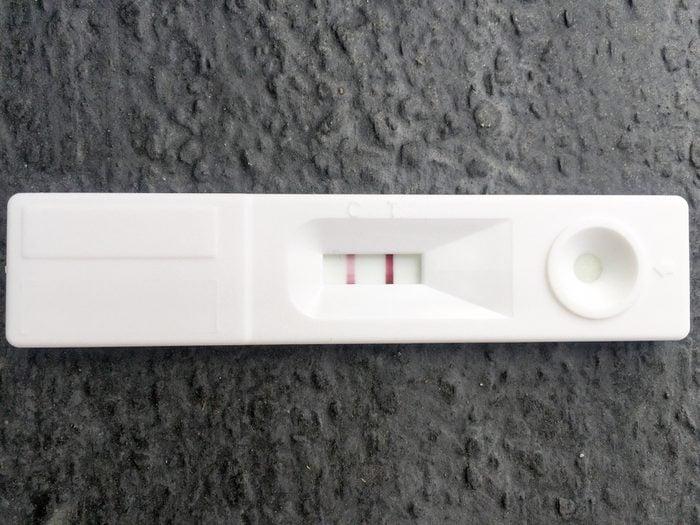 Pregnancy test on dark gray background. positive result.