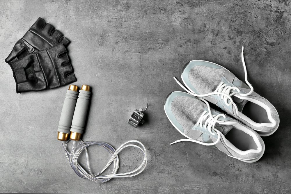 Weight-lifting gloves, jump rope, stopwatch, and sneakers