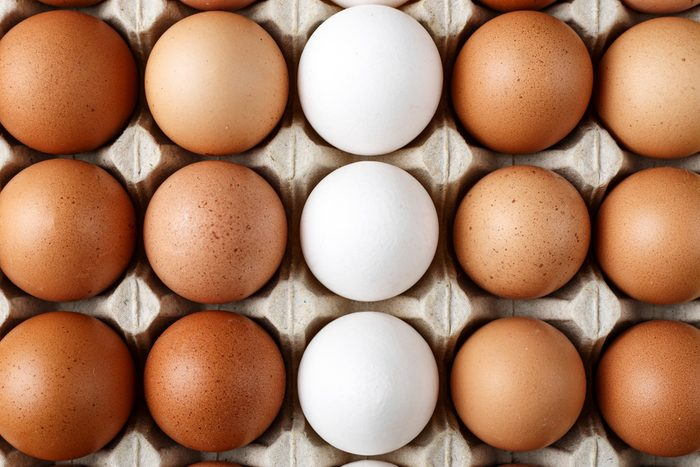 chicken eggs in a paper tray. close-up. space for text