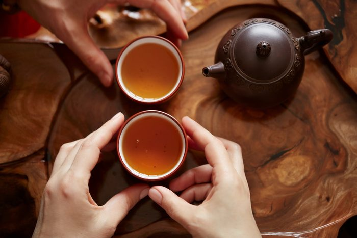 Top view tea set a wooden table for tea ceremony background.