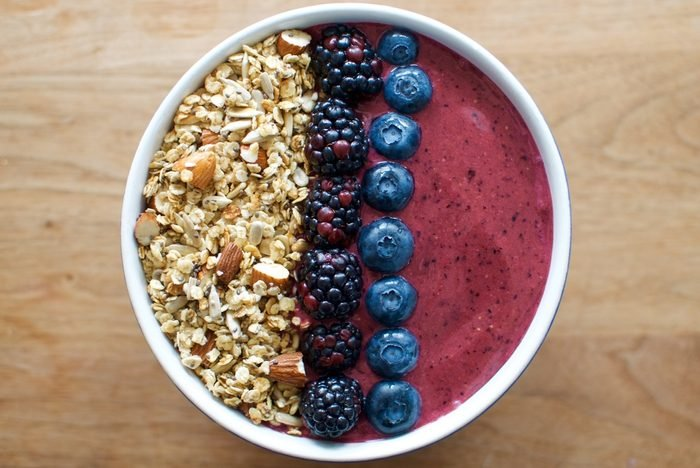 Smoothie bowl topped with berries and granola