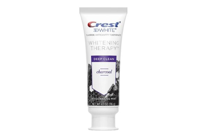 tube of Crest 3d White Whitening Therapy Charcoal Deep Clean Fluoride Toothpaste