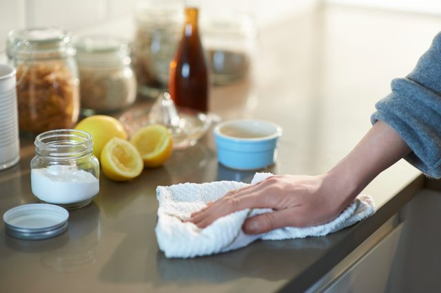 wiping down kitchen counter