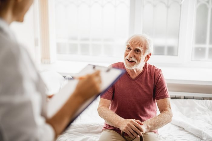 senior patient talking to health care worker