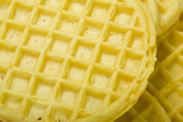 Frozen buttermilk waffles background; close up, macro view