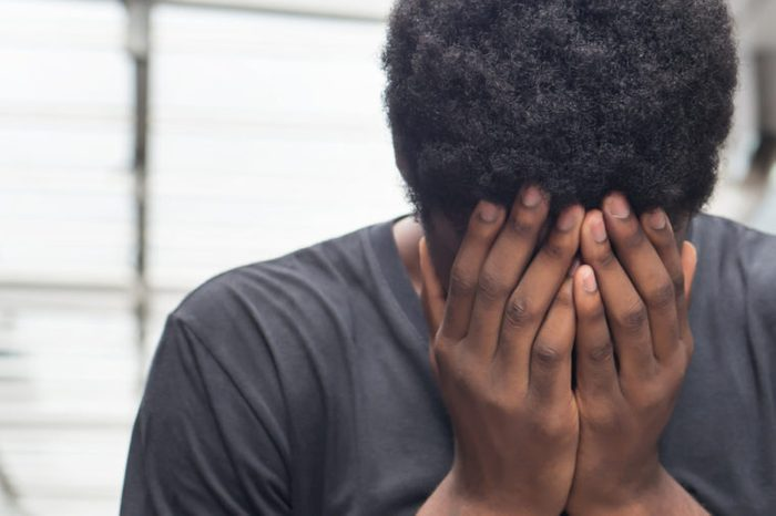 african man with face palm gesture stress or depression; portrait of depressed face palm african man or black man suffers from headache, stress, depression, failure concept; adult african man model