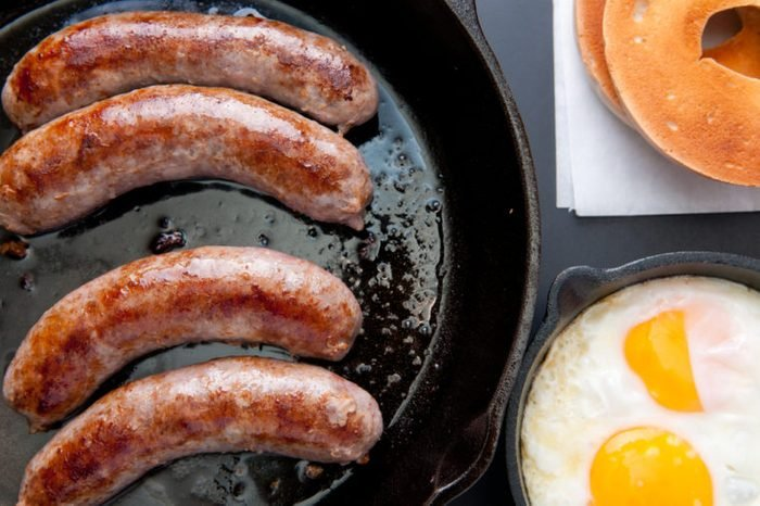 grilled sausage with eggs, bagel and hashbrowns breakfast