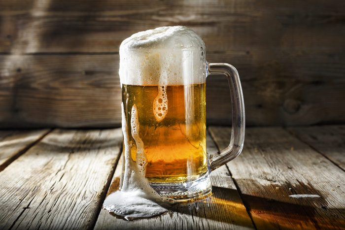 Mug of light beer with foam