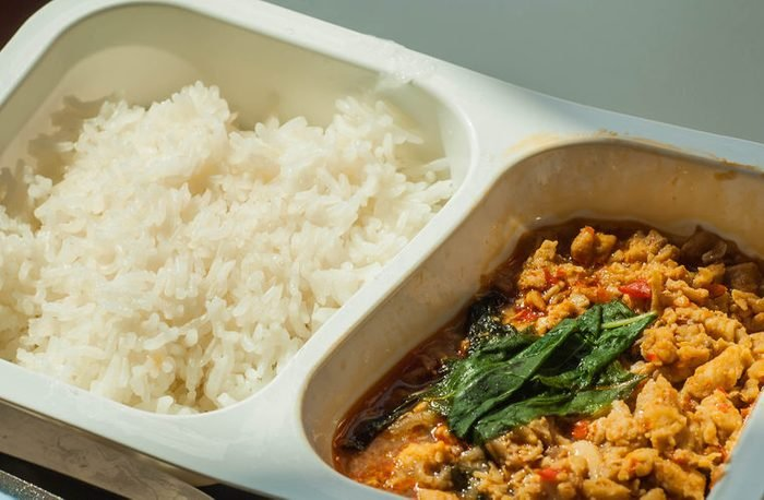 traditional thai food named pad kra pao in frozen food container