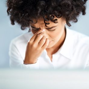 black woman sinus headache pressure stress