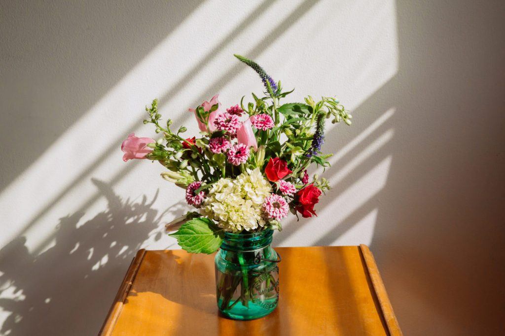 flowers in vase sitting on table