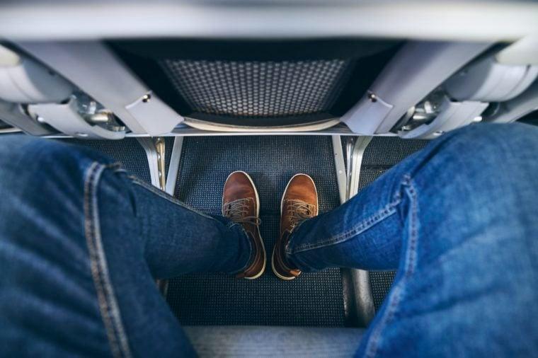 man legroom seats shoes feet airplane aisle