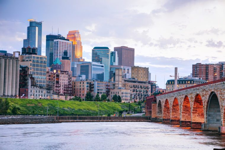 Downtown Minneapolis, Minnesota at night time as seen from the famous stone arch bridge