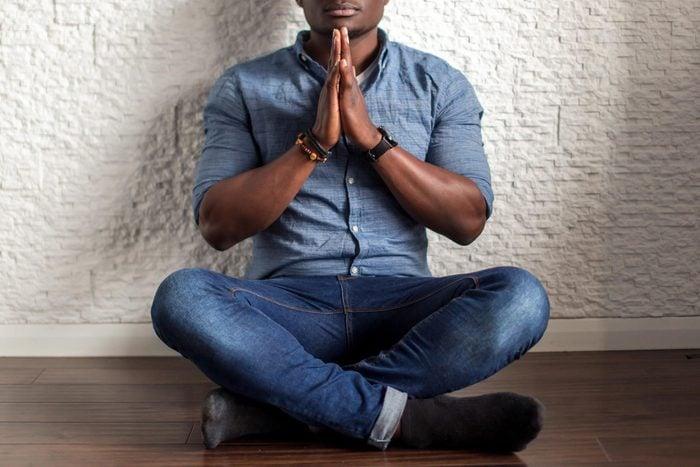 man sitting on the floor, meditating