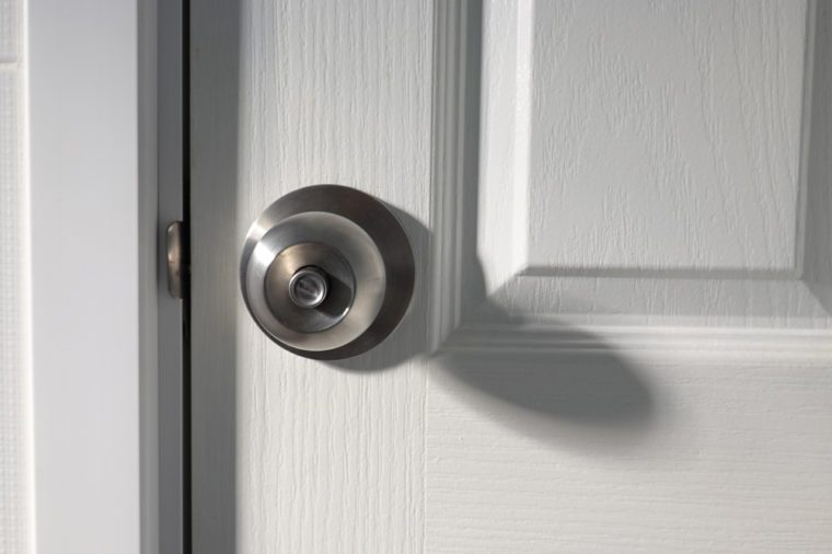 A doorknob on a wooden door