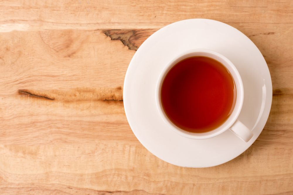 Cup of tea on a wooden background