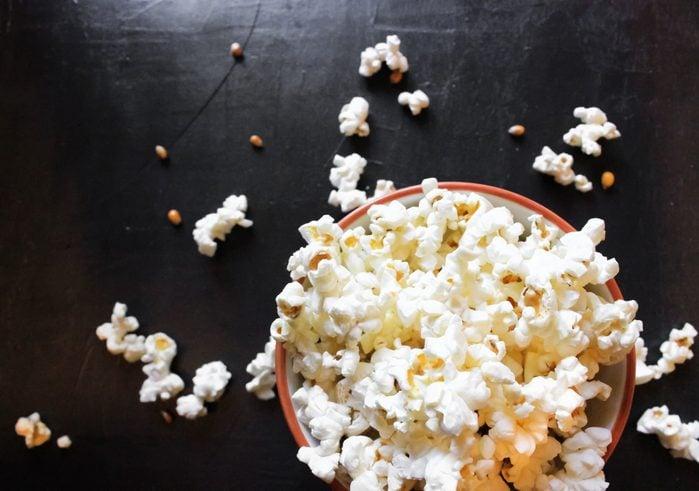 Popcorn in bowl food on black background