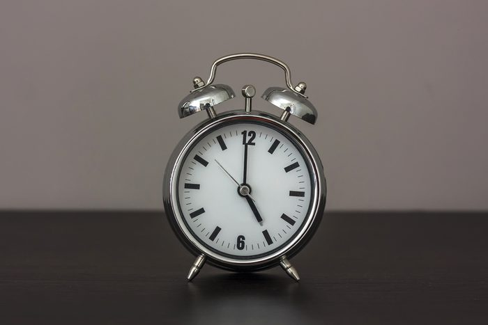 Alarm clock set at five.